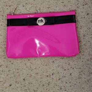 Two makeup bags two and five pieces of makeup. NWT